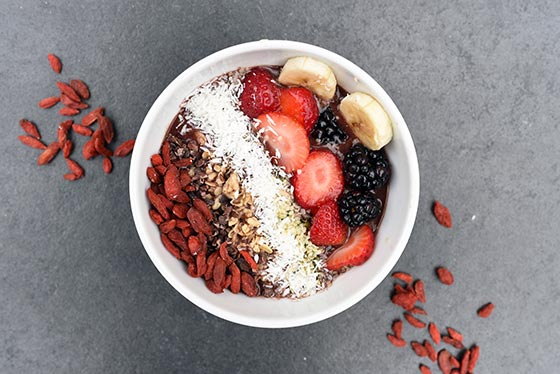 sambazon acai bowl topped with nuts and berries