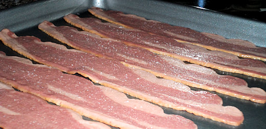cold bacon on baking pan