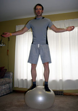 standing on exercise ball