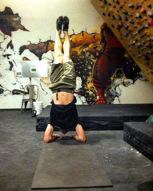 coach levi practices forearm stand at bkbs