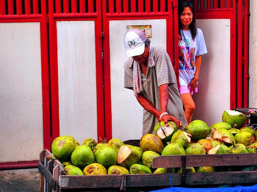 young coconut street vendor