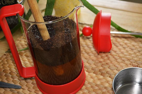 stirring coffee grounds in a French press