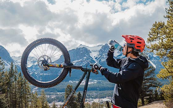 mountain biker drinking electrolytes from bottle