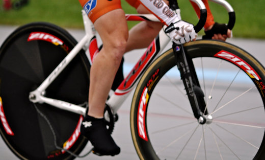 track cyclist with dropped chain