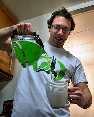 pouring a mug of green coffee