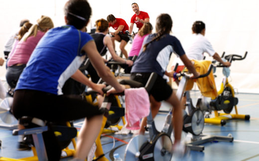 indoor cycling class with instructor