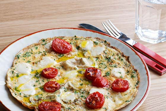 caprese omelet on table