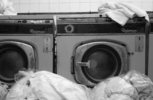 dirty laundry stacked at machines