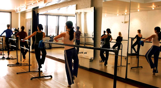men in a barre class