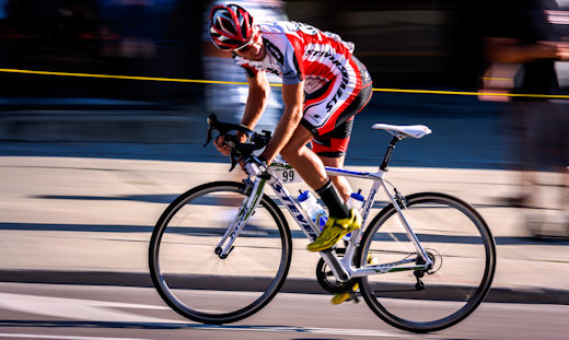 racing cyclist looking back over shoulder