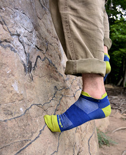 darn tough socks on rock