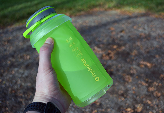 holding the hydrapak stash collapsible water bottle