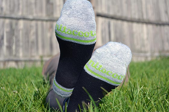 mitscoots running socks in black and green color scheme