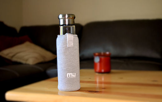 miu color glass water bottle in koozie