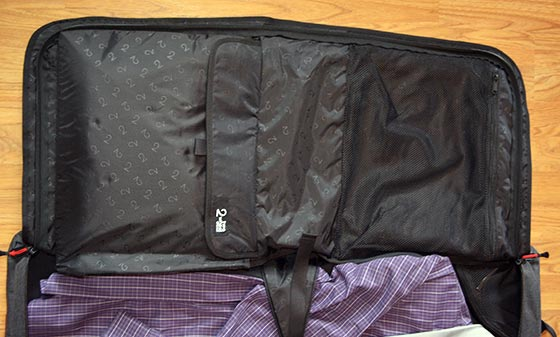 garment bag packed with laptop