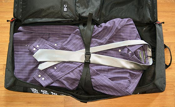 garment bag packed with shirt suit and tie