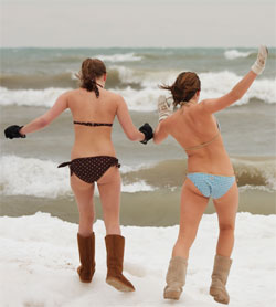 two girls do polar bear plunge