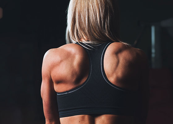 athletic woman with muscular shoulders